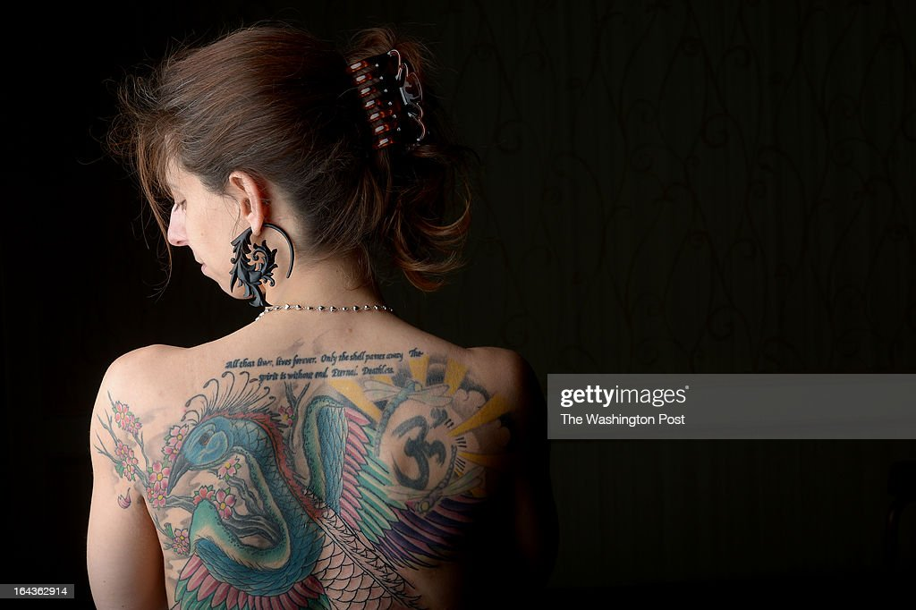 Angela Diorio of McLean Va shows off her back tattoo at the DC Tattoo Expo on January 13 2013 in Arlington VA