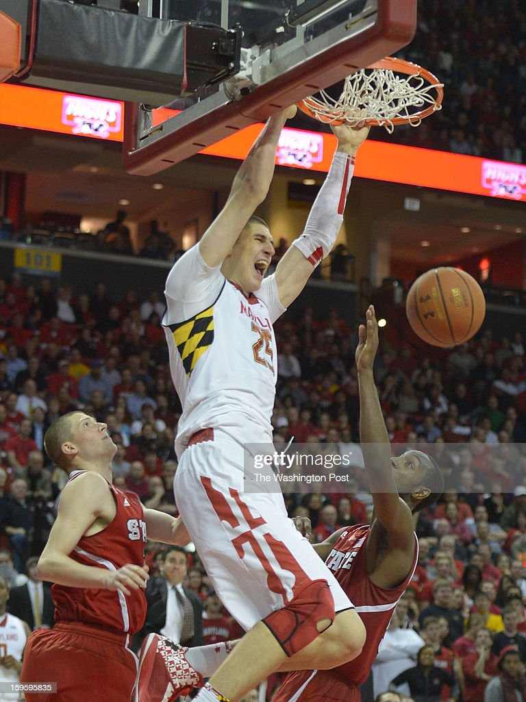 Maryland Terrapins center Alex Len (25) dunks over North Carolina State forward Scott Wood (15) (L) and forward C.J. Leslie (5) during 2nd half action on January 16, 2013 in College Park, MD