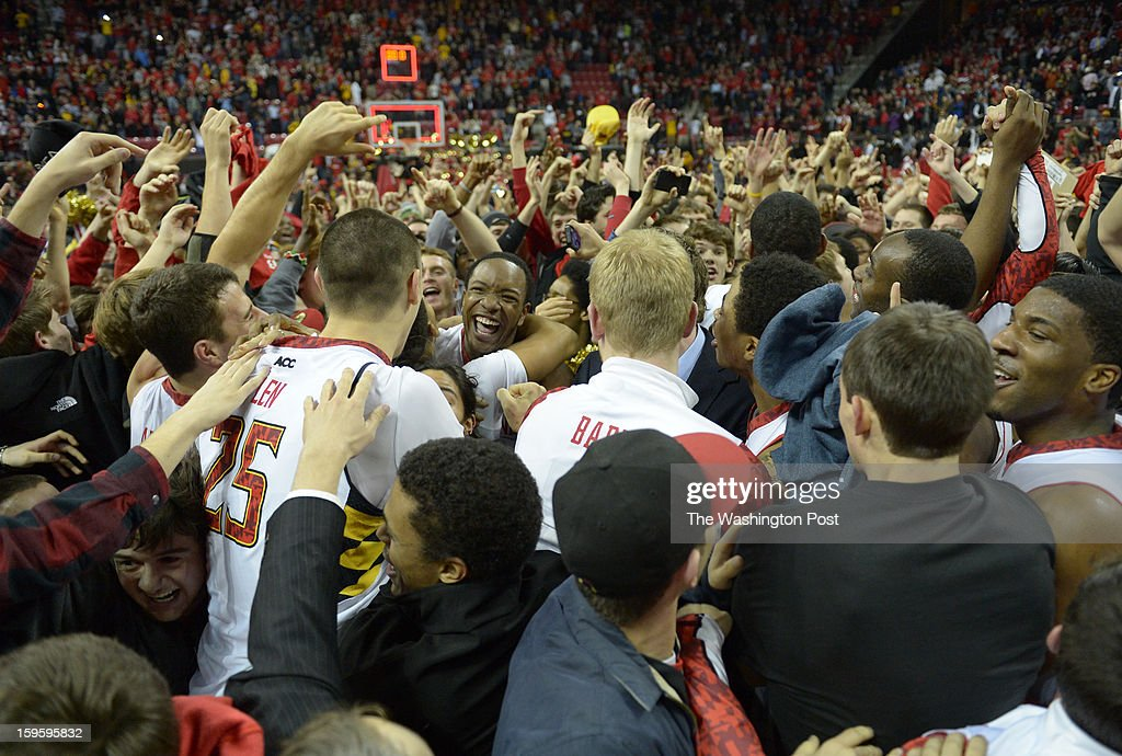 Maryland Terrapins center Alex Len (25) is mobbed after hitting the game winner against North Carolina State on January 16, 2013 in College Park, MD
