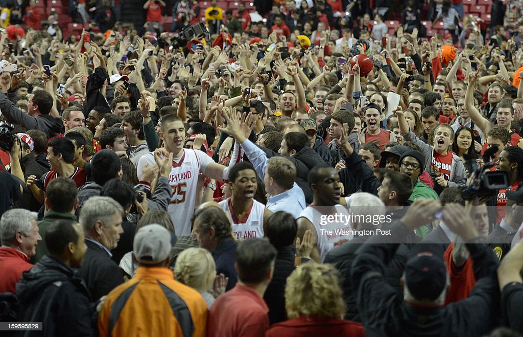 Maryland Terrapins center Alex Len (25) leaves the full court press put on by the student body after he hit the game winner for a 51-50 win over North Carolina State on January 16, 2013 in College Park, MD