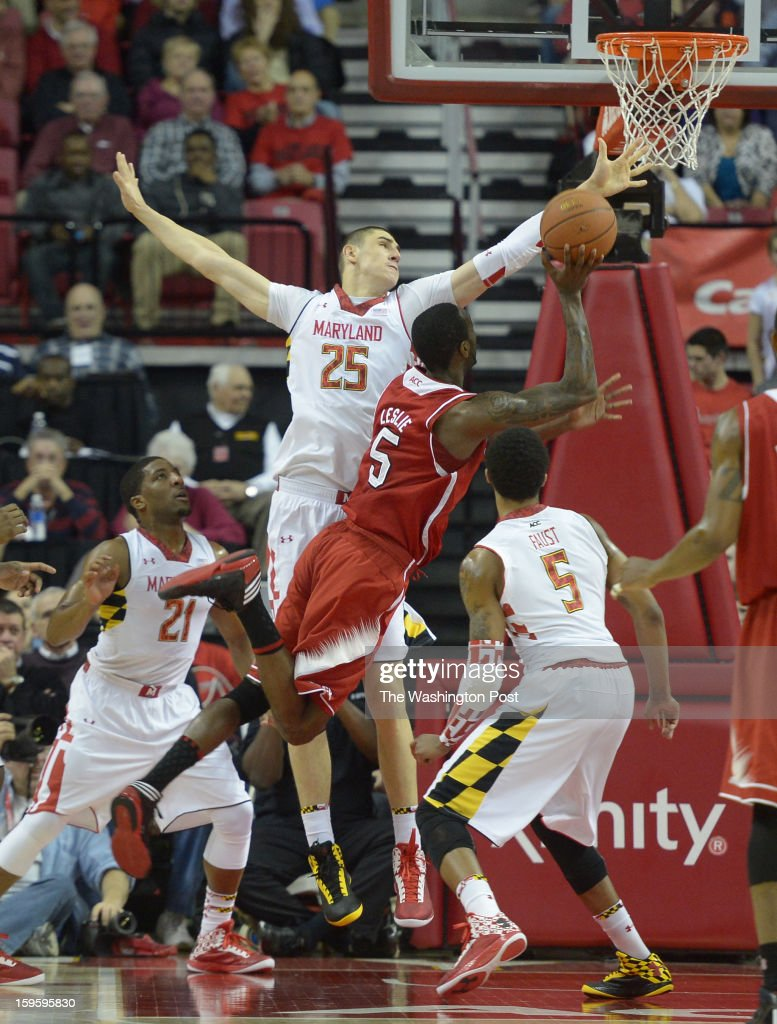 Maryland Terrapins center Alex Len (25) spreads his wings as North Carolina State forward C.J. Leslie (5) drives to the basket during 1st half action on January 16, 2013 in College Park, MD