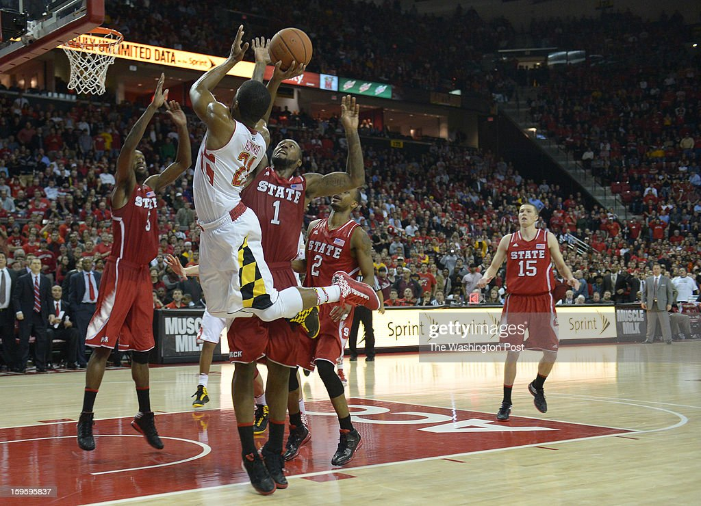 Maryland Terrapins guard Pe'Shon Howard (21) shoots as time expires and the shot was put back by center Alex Len (25) for a 51-50 win over North Carolina State on January 16, 2013 in College Park, MD