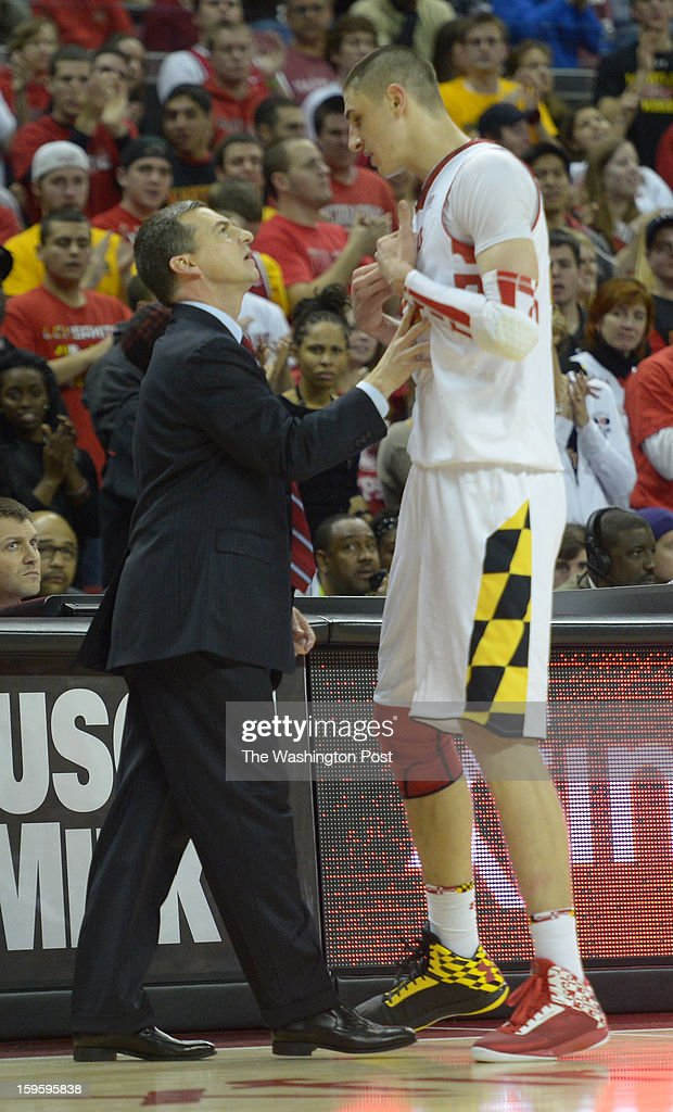 Maryland Terrapins head coach Mark Turgeon has a word with center Alex Len (25) after he committed a 2nd half foul against North Carolina State on January 16, 2013 in College Park, MD