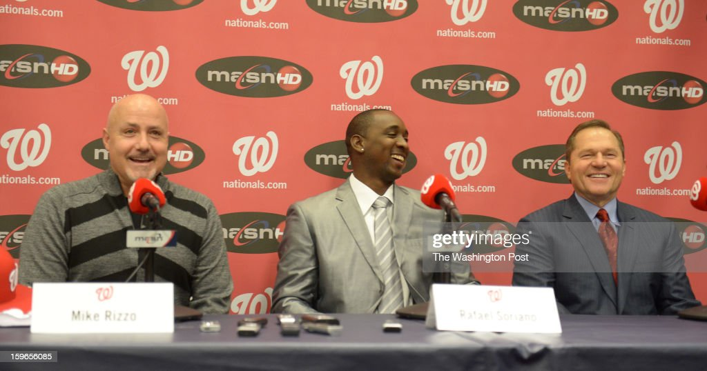 Washington Nationals GM Mike Rizzo, introduce pitcher Rafael Soriano(C) along with agent Scott Boras at a press conference on January 17, 2013 in Washington, DC