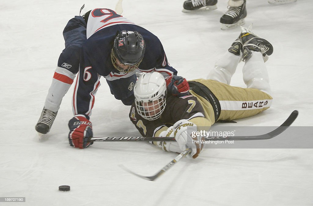 DeMatha F Kyle Coakley (6) and Landon Jones Lindner (7) battle for the puck during action on January 18, 2013 in Laurel, MD