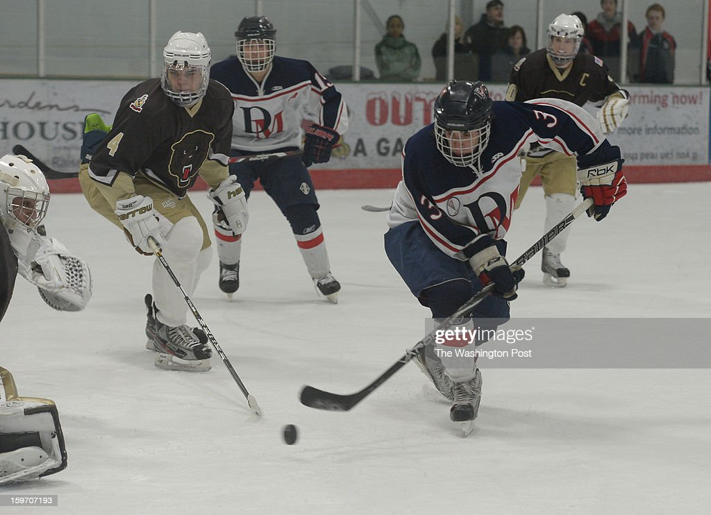 DeMatha F Spencer Keogh (3) hits a backhand goal against Landon on January 18, 2013 in Laurel, MD