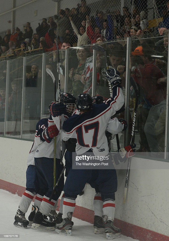 DeMatha F Spencer Keogh (3) is mobbed by his team following his 2nd period goal against Landon on January 18, 2013 in Laurel, MD