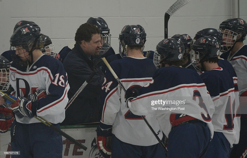 DeMatha head coach Tony MacAulay talks with his team during their 5-3 loss to Landon on January 18, 2013 in Laurel, MD