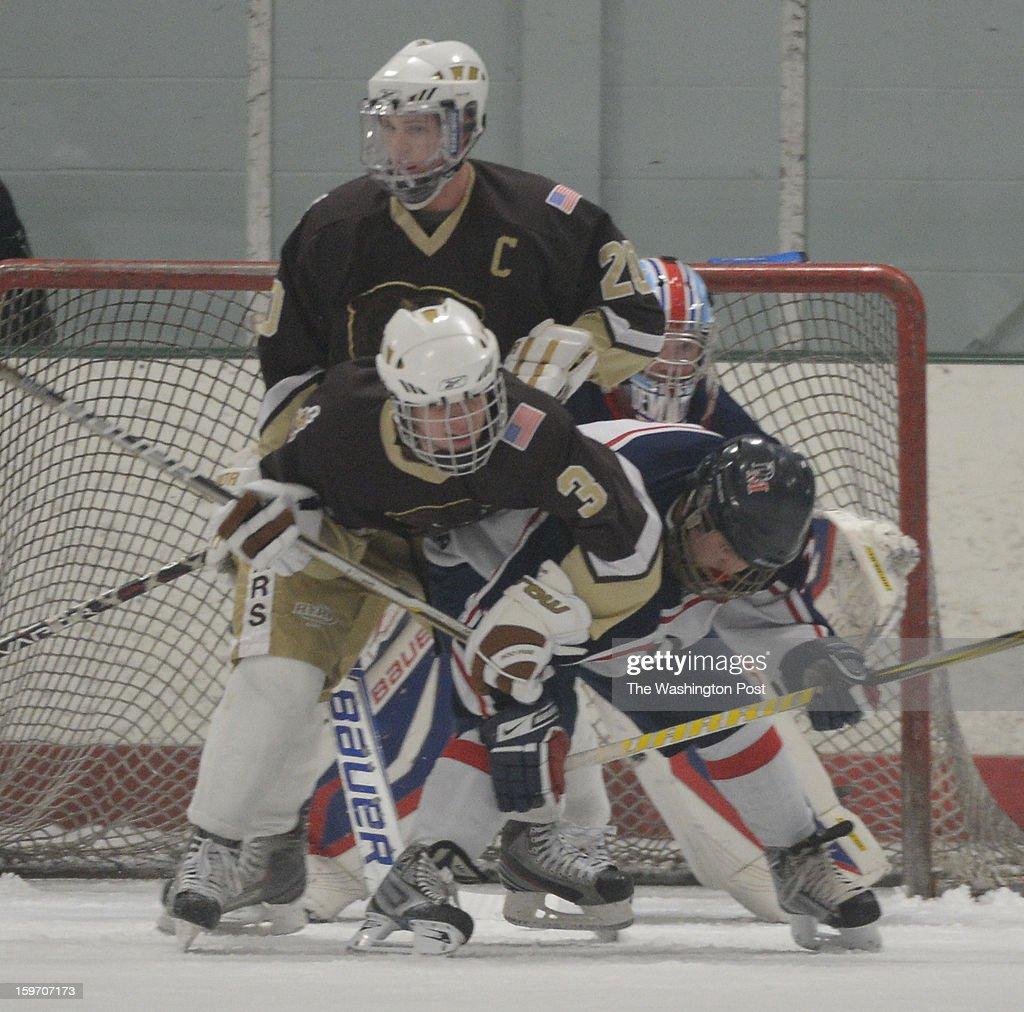 Landon F Colton Rupp (3) battles DeMatha D Shane Tracy (14) for position in front of the net during action on January 18, 2013 in Laurel, MD