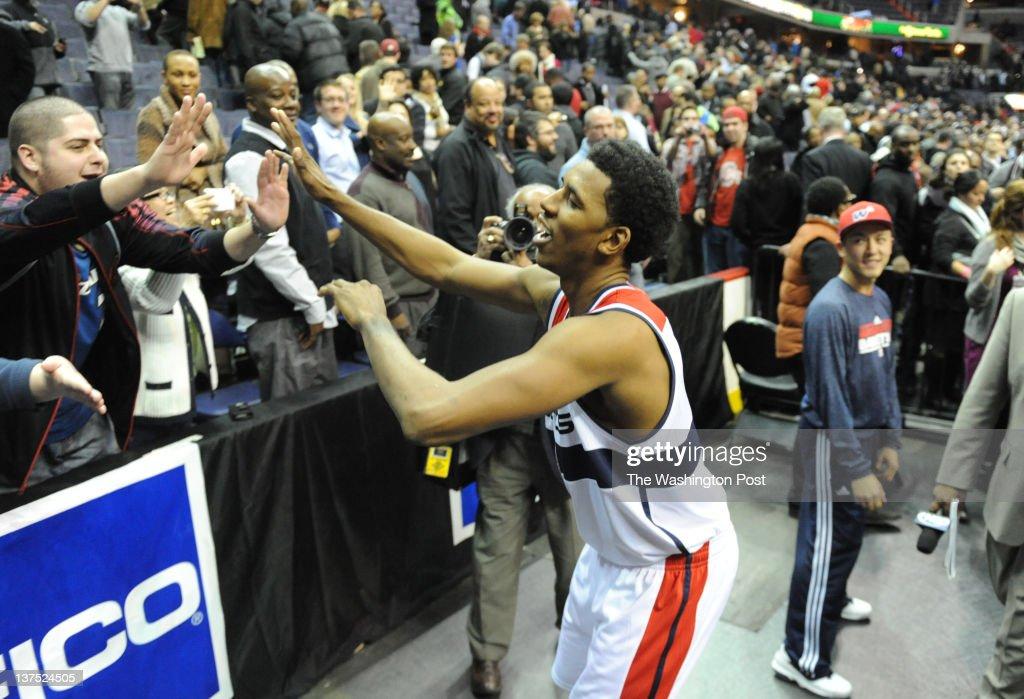 Washington Wizards shooting guard Nick Young (1) celebrates their 105-102 win over the Oklahoma City Thunder on January 18, 2012 in Washington, DC