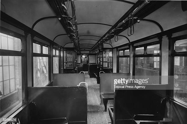 The interior of a District Line Underground railway carriage