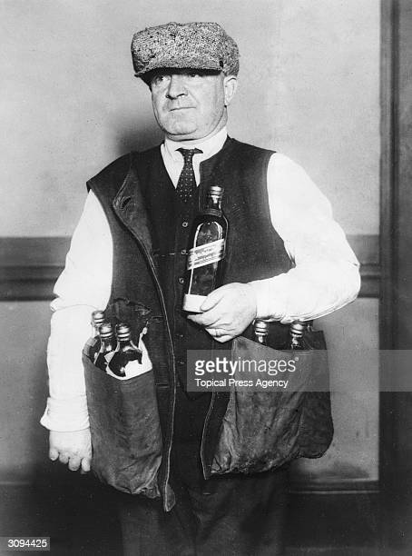 A revenue agent wearing a waistcoat designed to hide whisky during the prohibition era in America