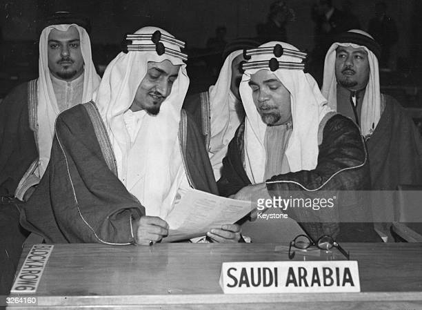 Faisal Ibn Abdul Aziz the Crown Prince of Saudi Arabia is sitting with Shaikh Hafiz Wahba and other members of the SaudiArabian delegation attending...