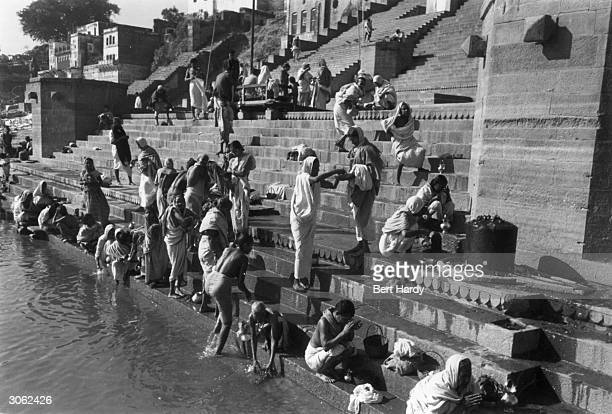 The main Ghat on the Ganges at Benares Crowds gather from all over India Tibet and Burma to bathe in the sacred river Original Publication Picture...