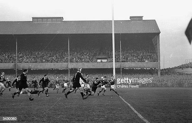 R C Stuart of the New Zealand rugby team known as the All Blacks scores his team's last try in the match against Ireland in Dublin winning the game...