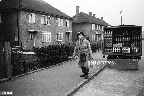 Milkman Ralph Fulcher does his rounds on the giant council estate near his home in Chigwell Essex He is about to emigrate to Canada with his wife and...