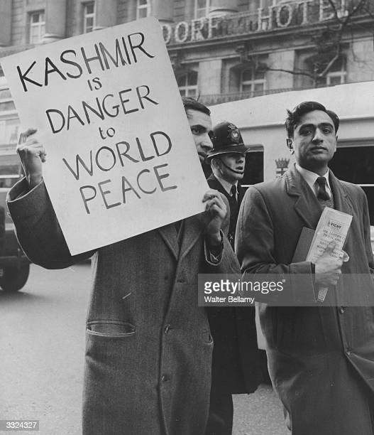 Pakistani demonstrators march outside India House London to highlight the threat to world peace posed by Kashmir