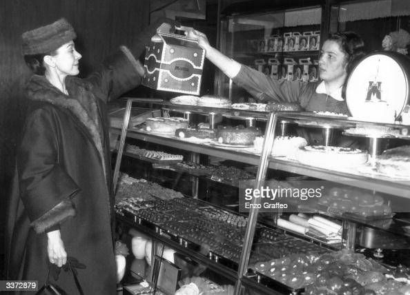 Prima ballerina Margot Fonteyn buys some panettone in a cakeshop in Milan She is currently performing in the 'Nutcracker Suite' at La Scala