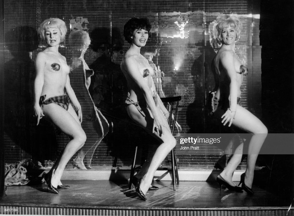 Dressed in miniscule fur bikinis, Kean Fluffles, Angela Parker and Audrey Crane, three of the glamorous girls performing in London's Casino de Paris in London's Soho.