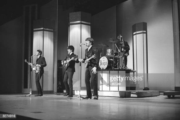 The Beatles from left to right Paul McCartney George Harrison John Lennon and Ringo Starr in concert at the London Palladium