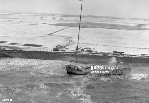 Pirate radio station Radio Caroline's ship 'Mi Amigo' runs aground at FrintononSea on the Essex coast during a storm