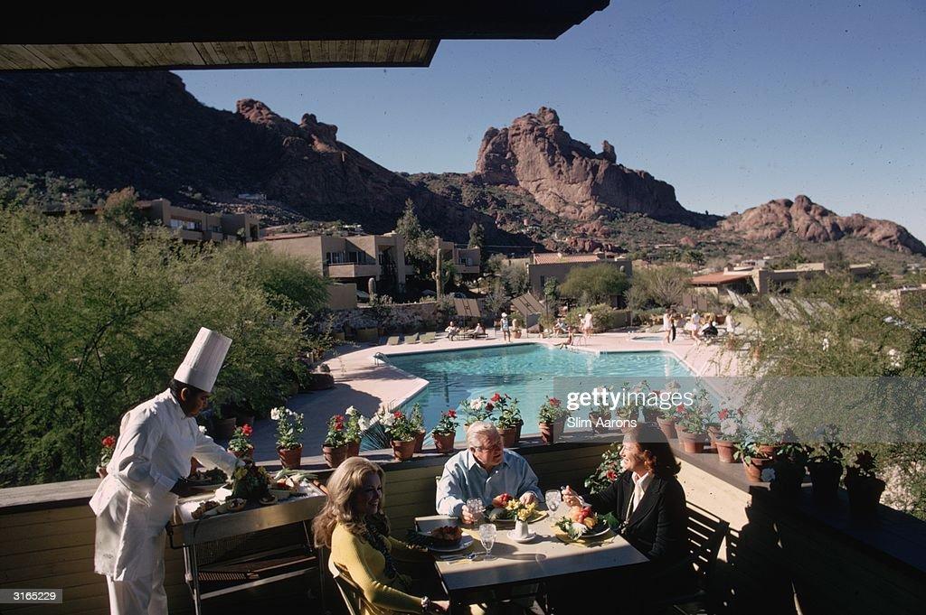 Mrs Bruce Leadbetter and Mrs Franz Talley visit John Gardiner at his luxury tennis ranch in Arizona.
