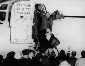 United States hostages departing an airplane on their return from Iran after being held for 444 days One of the hostages is waving his fists in the...