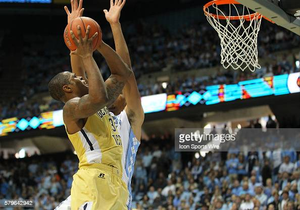 Georgia Tech Yellow Jackets guard Marcus GeorgesHunt puts up a shot while North Carolina Tar Heels forward Brice Johnson attempts to block him during...