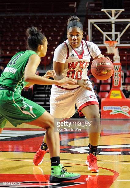 Western Kentucky Lady Toppers forward Simone Goods puts the ball on the floor and drives to the basket during an college basketball game between the...