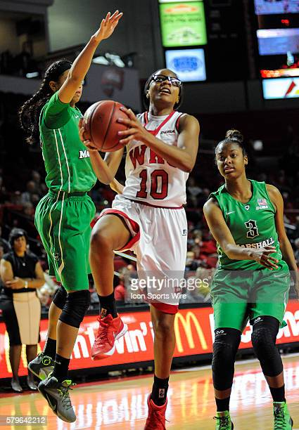 Western Kentucky Lady Toppers forward Tashia Brown gets fouled by Marshall Thundering Herd forward Chelsey Romero during an college basketball game...