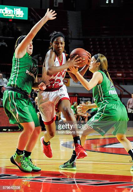 Western Kentucky Lady Toppers guard/forward Kayla Smith splits two Marshall defenders during an college basketball game between the Marshall...