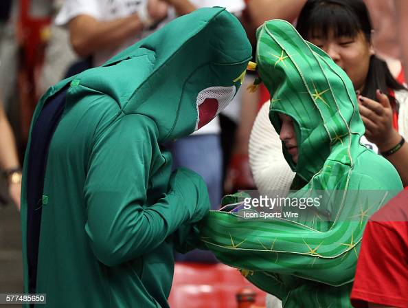 Two Arizona students dressed as Gumby and a cactus during Arizona's Pac12 NCAA college basketball game against Utah at McKale Center in Tucson Arizona