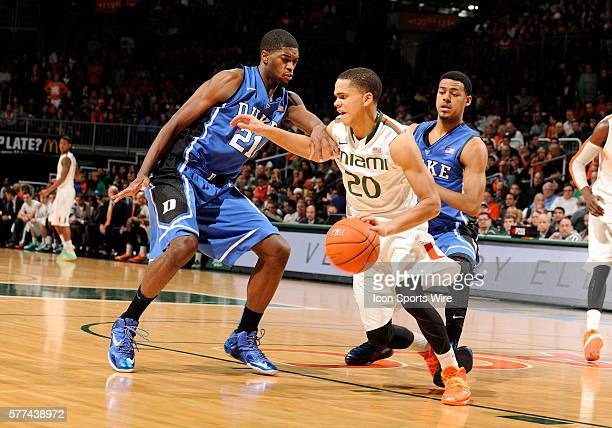 University of Miami guard Manu Lecomte is guarded by Duke University guardforward Amile Jefferson in Duke's 6746 victory at BankUnited Center Coral...