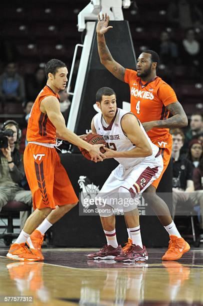 Boston College Eagles forward Ryan Anderson battles Virginia Tech Hokies guard Devin Wilson for the ball during the Boston College Eagles game...