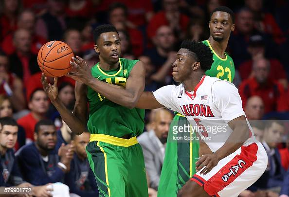 Arizona Wildcats forward Stanley Johnson defends Oregon Ducks guard Jalil AbdulBassit during the first half of the Pac12 college basketball game...