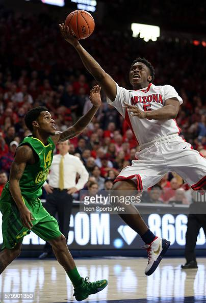 Arizona Wildcats forward Stanley Johnson drives on Oregon Ducks guard Ahmaad Rorie during the first half of the Pac12 college basketball game between...