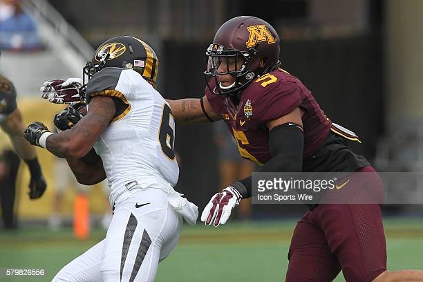 Minnesota Golden Gophers linebacker Damien Wilson chases down Missouri Tigers running back Marcus Murphy during the Buffalo Wild Wings Citrus Bowl...