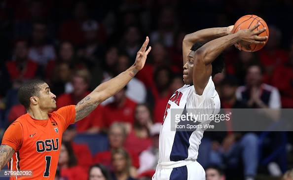 Oregon State Beavers guard Gary Payton II defends Arizona Wildcats forward Stanley Johnson during the second half of the Pac12 College Basketball...