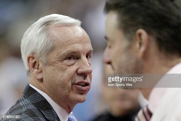 University of Louisville head coach Rick Pitino talks with University North Carolina head coach Roy Williams before the start of the game at the KFC...