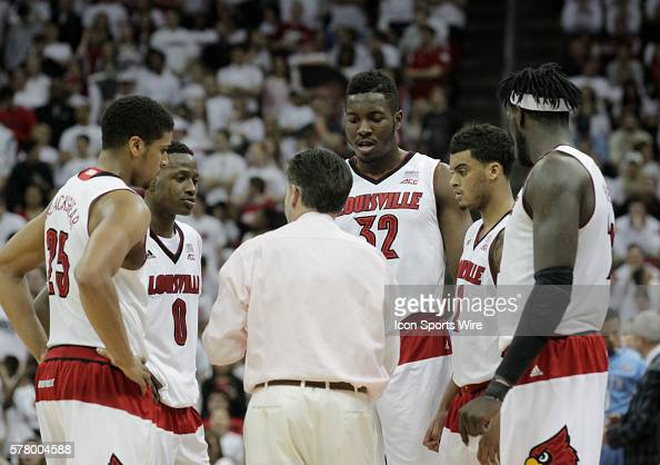 University of Louisville head coach Rick Pitino talks to his team during a time out against the University North Carolina during the first half of...