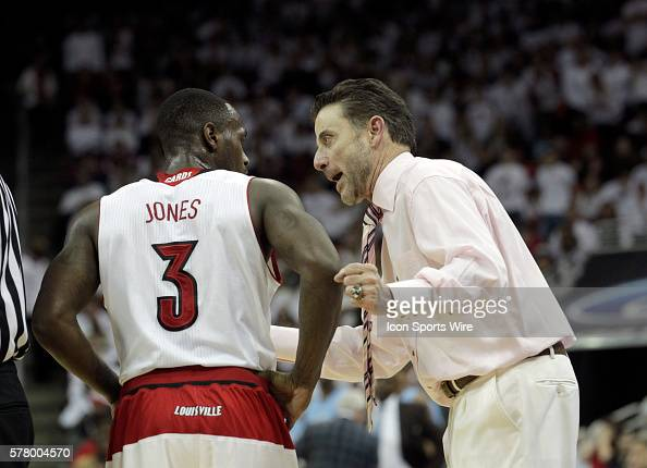 University of Louisville head coach Rick Pitino talk with Chirs Jones during their game against the University North Carolina at the KFC Yum Center...
