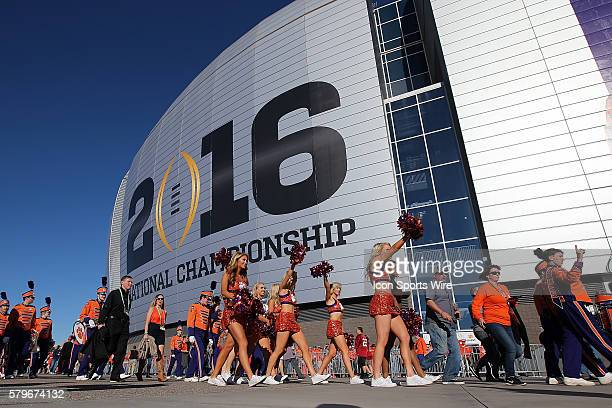 Clemson Tigers cheerleaders walk outside of the University of Phoenix Stadium in Glendale Az before the start of the College Football Playoff...