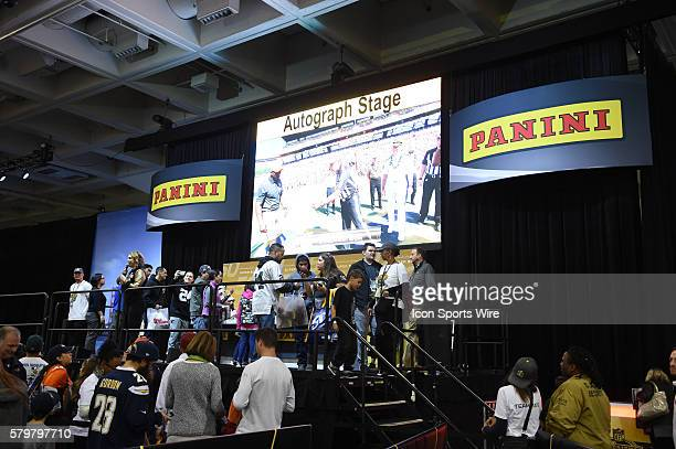 Fans gather at the Panini Autograph Stage during The NFL Experience for Super Bowl 50 at the Moscone Center in San Francisco CA