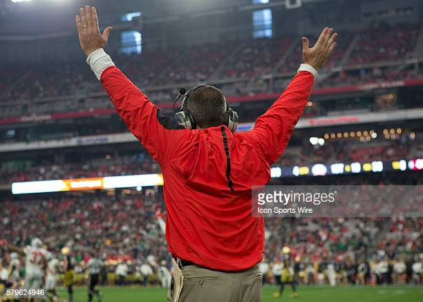 Ohio State Buckeyes head coach Urban Meyer signals victory by raising his hands in the air during the BattleFrog Fiesta Bowl game between the Ohio...
