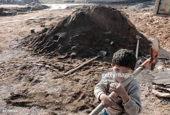 January 2017 Wardak Iraq Boy with shovelKakais repairing destroyed house The Kakai Kurds are returning to their homes as Mosul offensive continiues...