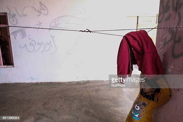 January 2017 Wardak Iraq Kakai girl in front of ISIL graffiti The Kakai Kurds are returning to their homes as Mosul offensive continiues The Kakai...