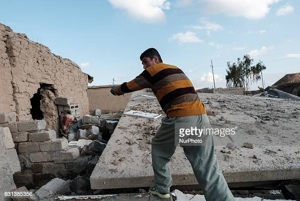 January 2017 Wardak Iraq Kakai man walk through rubble of destroyed building The Kakai Kurds are returning to their homes as Mosul offensive...