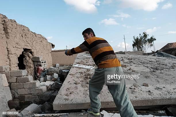 January 2017 Wardak Iraq Kakai man walk through rubble of destroyed building The Kakai Kurds are returning to their homes as Mosul offensive...