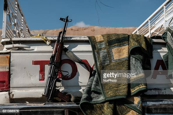 January 2017 Wardak Iraq Peshmerga Kalashnikov rifle at Toyota car The Kakai Kurds are returning to their homes as Mosul offensive continiues The...
