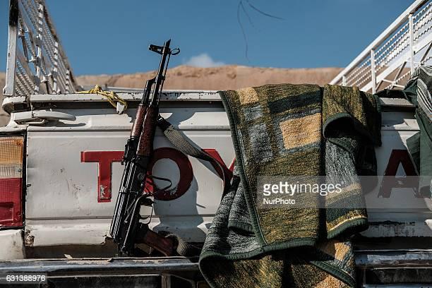 January 2017 Wardak Iraq Peshmerga Kalashnikov rifle at Toyota car The Kakai Kurds are returning to their homes as Mosul offensive continiues The...